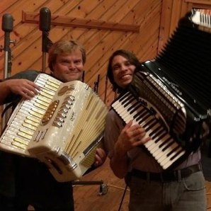 Alex Meixner and Jack Black pose with accordions